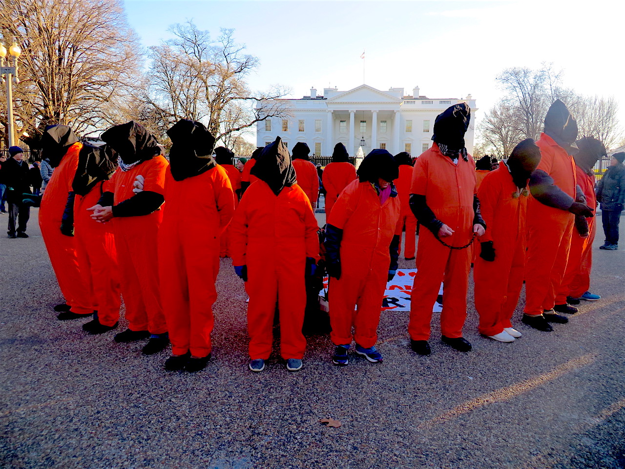 Witness Against Torture campaigners form a circle outside the White House towards the end of the annual vigil calling for the closure of Guantanamo, on January 11, 2019 (Photo: Andy Worthington).