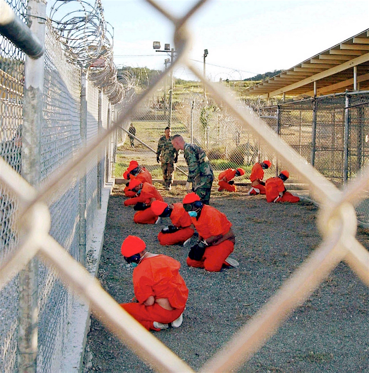 One of the photos taken on the day Guantanamo opened, January 11, 2002, by Shane T. McCoy of the US Navy.