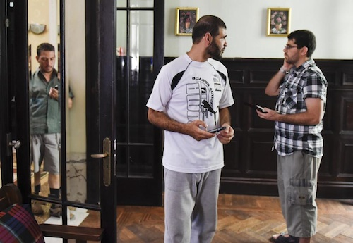 Three of the six Guantanamo prisoners given new homes in Uruguay in December 2014. From L to R: Adel bin Muhammad El-Ouerghi, Ali Husain Shaaban and Omar Abdelhadi Faraj in the house they share in Montevideo (Photo: Matilde Campodonico/AP).