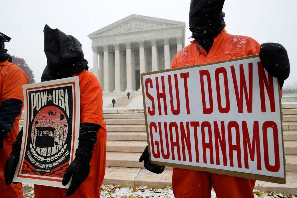 Protestors outside the Supreme Court on December 5, 2007, on the day that the Supreme Court was hearing arguments in Boumediene v. Bush, the case regarding the Guantanamo prisoners' habeas corpus rights that was decided in the prisoners' favor in June 2008 (Photo: Alex Wong/Getty Images).