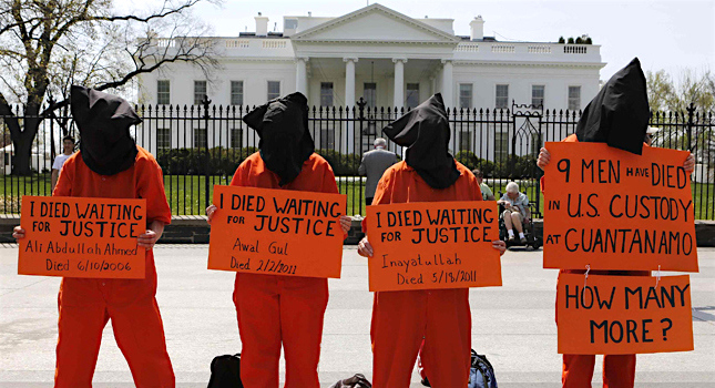 Campaigners with Witness Against Torture remind President Obama of the nine deaths that have occurred at Guantanamo at a protest in April 2013.