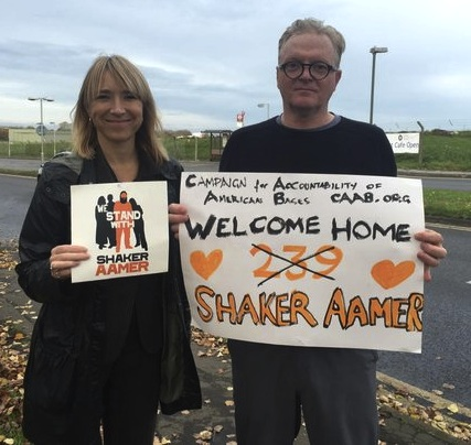 Joanne MacInnes, the co-director of We Stand With Shaker and campaigner Andrew Jackson at Biggin Hill airfield for Shaker Aamer's return home from Guantanamo.