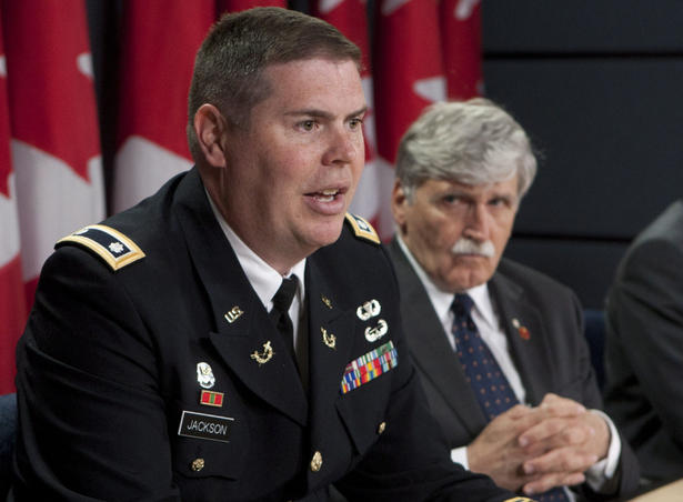 Lt. Col. Jon Jackson, one of Omar Khadr's military lawyers, with Canadian Senator Romeo Dallaire at a press conference in Ottawa on Thursday to demand Khadr's return from Guantanamo (Photo: Adrian Wyld/The Canadian Press).