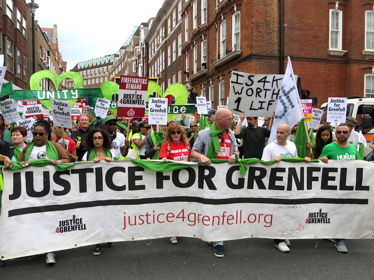 Justice for Grenfell: banner on a march in central London on June 16, 2018, just two days after the first anniversary of the fire in June 2017 that killed 72 people (Photo: Andy Worthington).