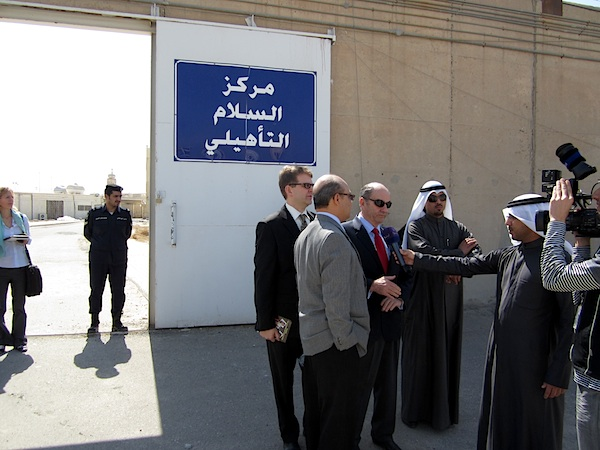 The US attorney Tom Wilner speaking to Kuwaiti media outside the rehabilitation center for former Guantanamo prisoners on February 23, 2012. To his right (also in a black suit) is Barry Wingard, the military defense attorney for Fayiz al-Kandari (Photo: Andy Worthington).