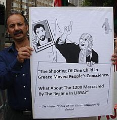A protestor holds up a poster outside the Libyan embassy in London on the 13th anniversary of the Abu Salim prison massacre, June 29, 2009