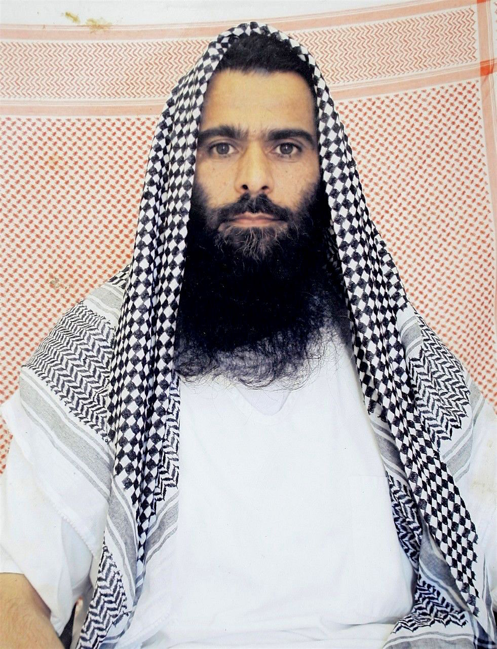 "Mohammad Rahim, an Afghan prisoner at Guantanamo, regarded as a ""high-value detainee,"" in photo taken by representatives of the International Committee of the Red Cross, who made it available to his family, who, in turn, made it publicly available."
