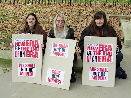 The two young women in the centre and the right of this photo live on the New Era Estate in Hoxton, and were part of a group of protestors that, on December 1, 2014, had just handed in a petition - of nearly 300,000 signatures - calling on David Cameron to protect them from the rapacious US property developers (Westbrook Holdings) who bought their estate earlier this year and now want to remove the tenants from the flats in which many have lived for decades, paying rents similar to those in council housing or housing associations. If evicted, many of these hardworking people will have to leave London entirely, because of the rampant greed in the capital that shows no sign of abating (Photo by Andy Worthington).