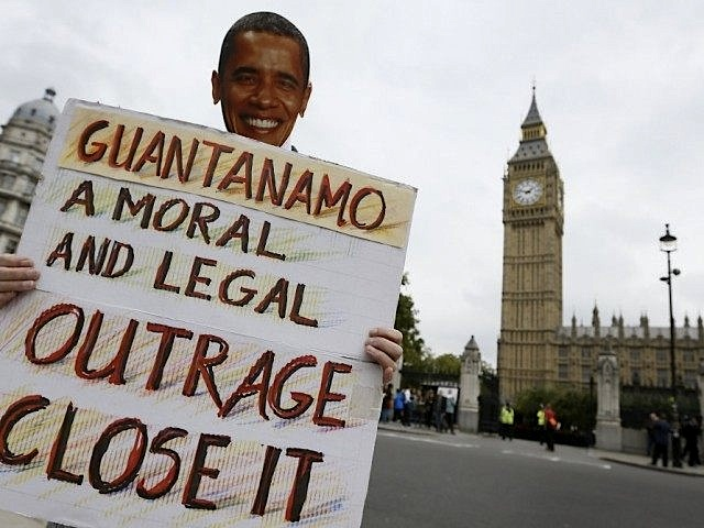 A campaigner wearing a President Obama mask calls for the closure of Guantanamo in London (Photo: AP/Kirsty Wigglesworth).