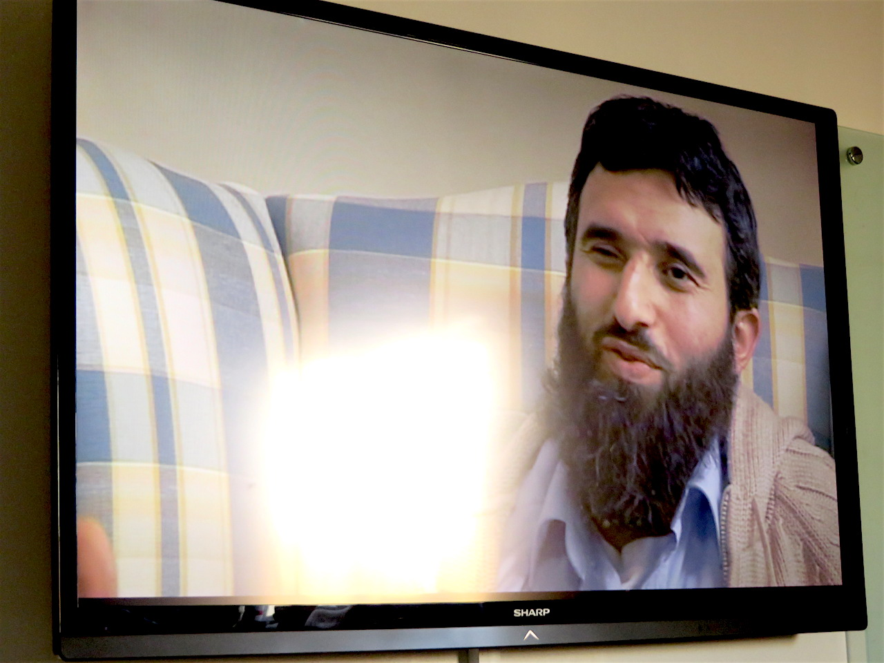 A screenshot of former Guantanamo prisoner Omar Deghayes in 'Outside the Law: Stories from Guantanamo', shown at the University of Westminster on November 17, 2017 (Photo: Andy Worthington).
