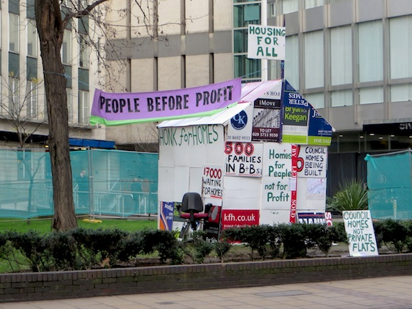 The house made out of estate agents' boards erected outside Lewisham Council's offices in Catford, south east London, by the campaigning group People Before Profit, highlighting housing need in the borough (Photo: Andy Worthington).