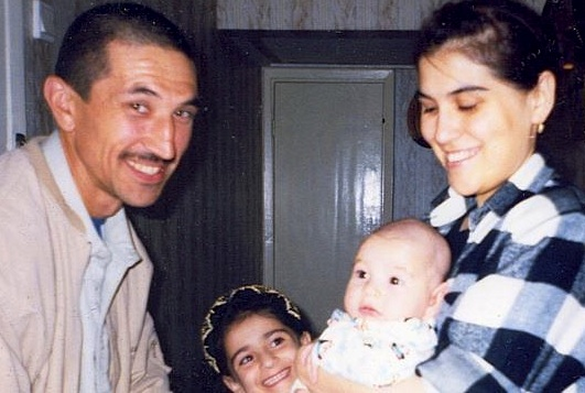 Guantanamo prisoner Ravil Mingazov, who us one of 36 men eligible for Periodic Review Boards, but who have not yet been given a date when their reviews will take place. This photo is of Ravil with his family, in a photo taken before his capture.
