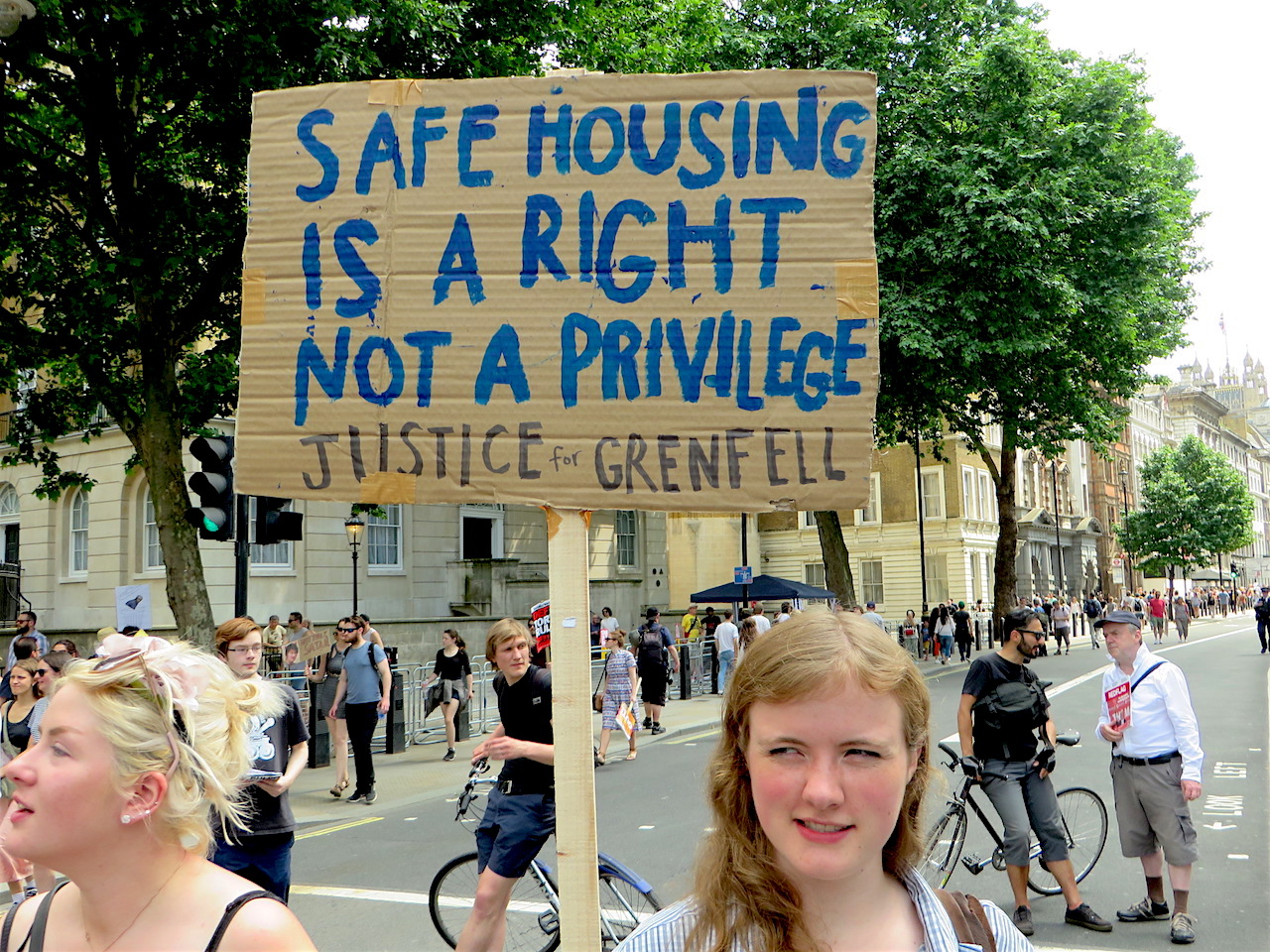 'Safe housing is a right not a privilege': a placard at the 'Protest Against Theresa May' outside Downing Street on June 17, 2017 (Photo: Andy Worthington).