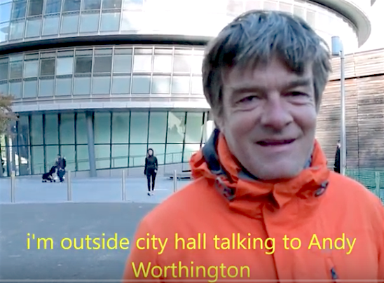 A screenshot from a video of Andy Worthington discussing the housing crisis outside City Hall on November 3, 2018.