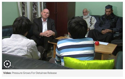 A screenshot of Ian Woods of Sky News interviewing two of Shaker Aamer's sons, Mikhail and Faris, in the presence of Saeed Siddique, Shaker's father-in-law, and Shaykh Suliman Ghani, the family's former imam.