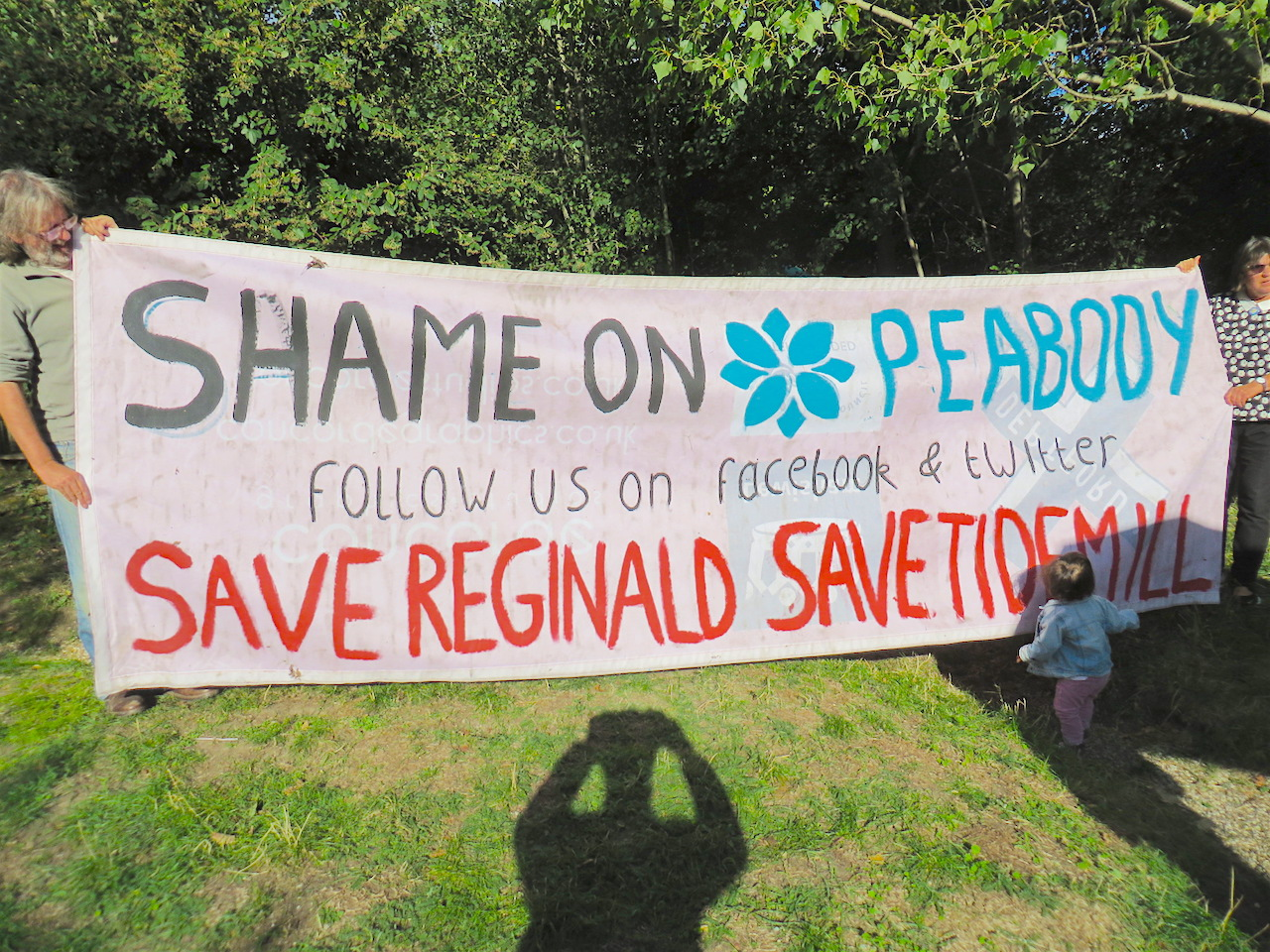 'Shame on Peabody': a banner held by campaigners in the Old Tidemill Wildlife Garden in Deptford, which has been occupied since August 29, 2018 to prevent Lewisham Council and Peabody from destroying it - and 16 structurally sound council flats next door - as part of a housing project (Photo: Andy Worthington).