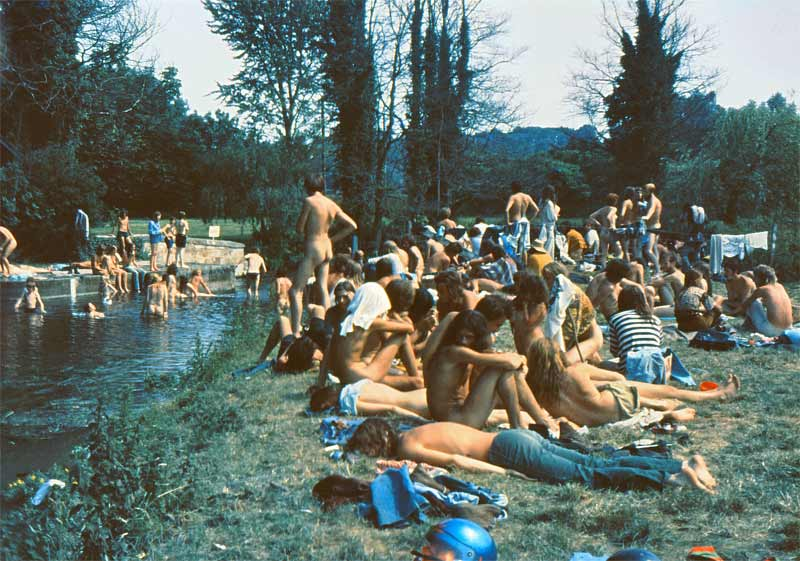 Revellers at the Stonehenge Free Festival in 1975 relax at the River Avon (photo by Roger Hutchinson).