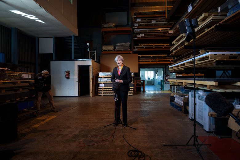Despite the Tories doing well in the local elections on May 4, 2017, Theresa May remains a distant leader, unable to connect with ordinary people, as this photo of her making a statement at the end of a factory tour in Brentford shows.