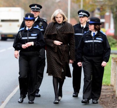 Theresa May flanked by police - a fitting image for the fundamental lack of openness and trust exhibited by our unelected leader.
