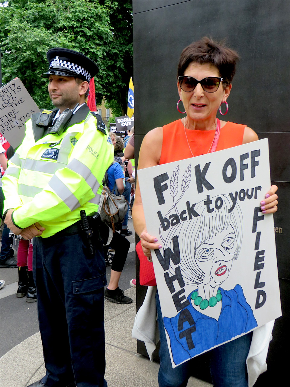 """F*ck off back to your wheat field"": a great placard from the 'Not One Day More' protest against Theresa May and the Tories in London on July 1, 2017 (Photo: Andy Worthington)."
