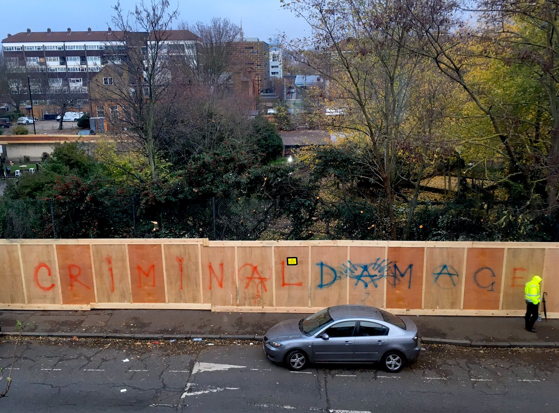 'Criminal damage': graffiti on the hoarding erected around the Old Tidemill Wildlife Garden in Deptford after its violent eviction on October 29, 2018 (Photo: Ruby Radburn).