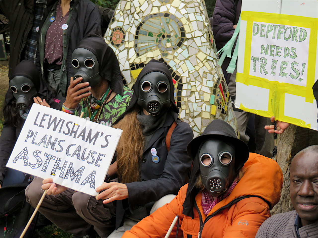 Save Reginald Save Tidemill campaigners photographed wearing gas masks to highlight the environmental costs of the proposed re-development of the old Tidemill school site, including the Old Tidemill Wildlife Garden (Photo: Andy Worthington).