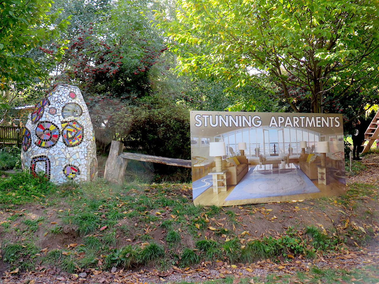 'Stunning apartments': a reclaimed sign brought to the Old Tidemill Wildlife Garden prior to its violent eviction on October 29, 2018 (Photo: Andy Worthington).