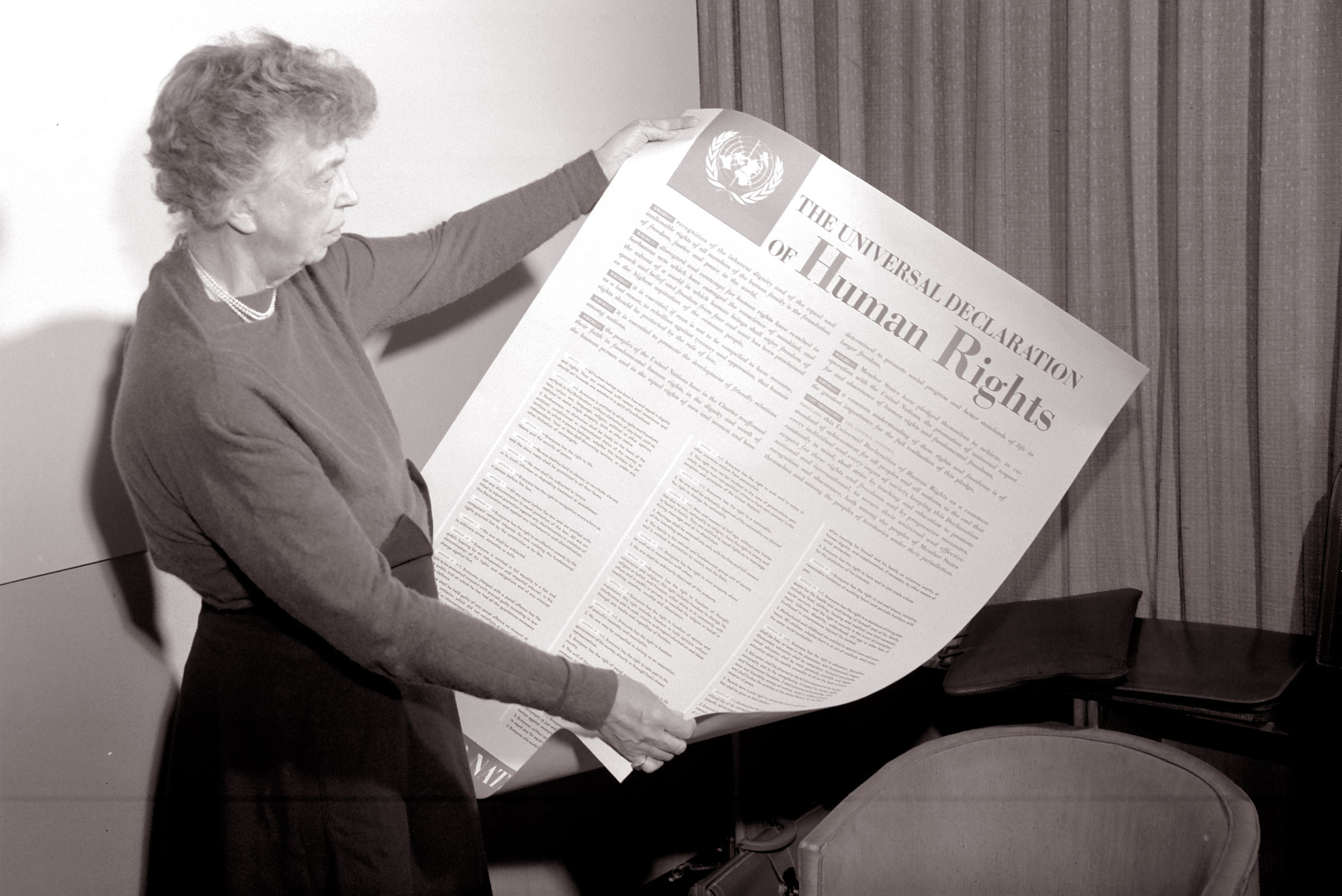 Eleanor Roosevelt holds up a copy of the Universal Declaration of Human Rights in 1948. Roosevelt, the wife of the former US president, who had a deep interest in the rights of refugees, was chosen to chair the UN Human Rights Commission, when it was established on February 16, 1946 to draft a Declaration of Human Rights.