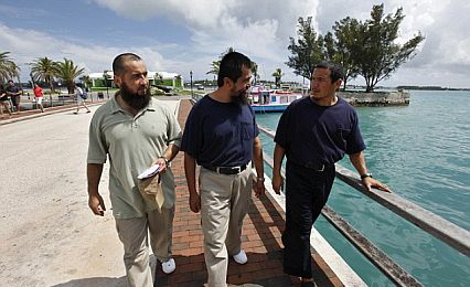 Khalil Mamut (right) and Ablikim Turahun (left) enjoy their freedom in Bermuda with Salahidin Abdulahad (center)
