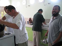 Four of the recently released Uighurs from Guantanamo in the kitchen of their new home in Koror, Palau, November 2, 2009 (Photo: AFP)