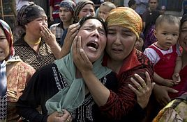 Uighur women grieving for their menfolk, who were taken away by the Chinese authorities after the protest in Urumqi (AP photo)
