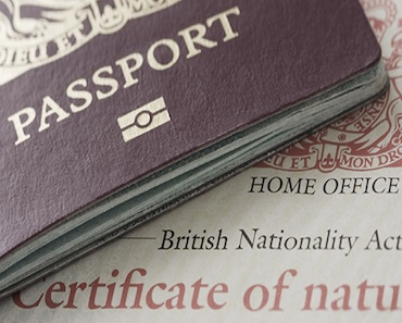 A UK passport and a certificate of naturalisation.