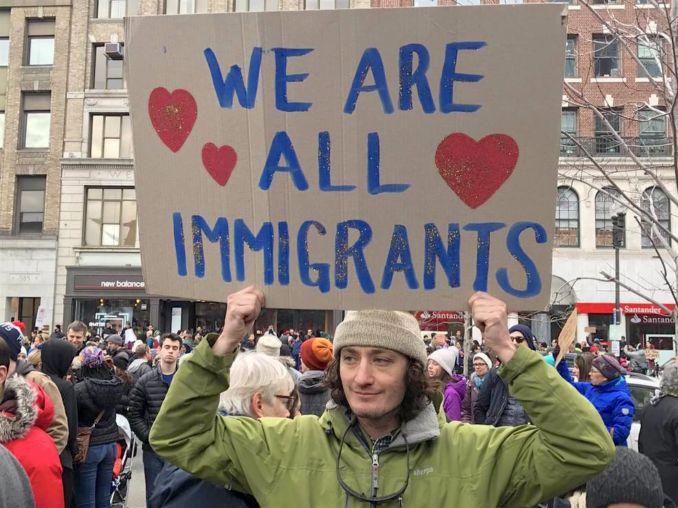 """We are all immigrants"": a protestor in Boston's Copley Square on January 29, 2017, after Donald Trump issued his first Muslim ban (Photo: NBC Boston)."