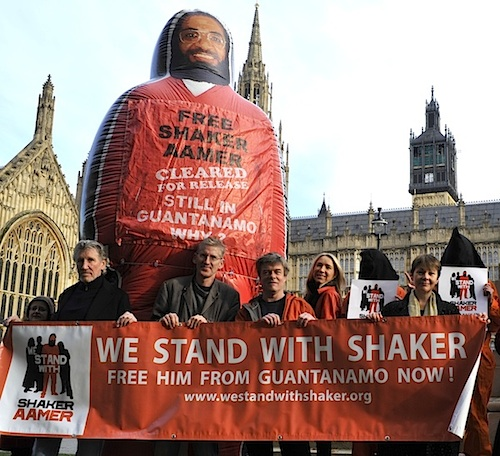 The launch of the We Stand With Shaker campaign outside the Houses of Parliament on November 24, 2014, featuring, from L to R: Roger Waters, Clive Stafford Smith, Andy Worthington, Joanne MacInnes and Caroline Lucas.