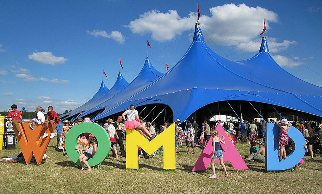 Children on the WOMAD sign at the 2012 festival in Wiltshire (Photo: Andy Worthington).